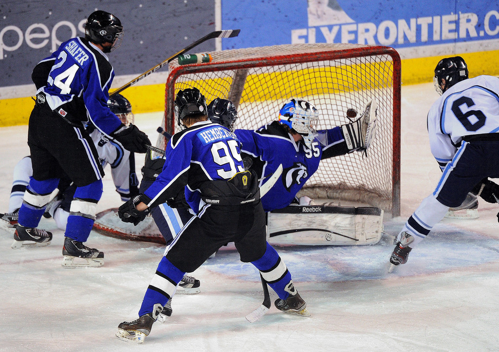 . DENVER, CO. - FEBRUARY 28: Cougars goalie Brandan Alcorn (55) deflected a puck away from the net early in the first period as Mustangs\' forward Matt Morelli (6) looked for a rebound. Ralston Valley High School took on Resurrection Christian Thursday night, February 28, 2013 in a semifinal match in the Colorado State Ice Hockey Championships at Magness Arena in Denver. (Photo By Karl Gehring/The Denver Post)