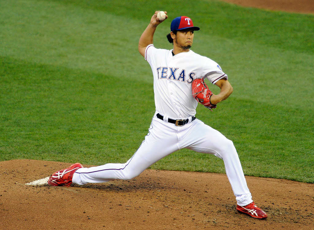 . American League All-Star Yu Darvish #11 of the Texas Rangers pitches against the National League All-Stars in the third inning during the 85th MLB All-Star Game at Target Field on July 15, 2014 in Minneapolis, Minnesota.  (Photo by Hannah Foslien/Getty Images)