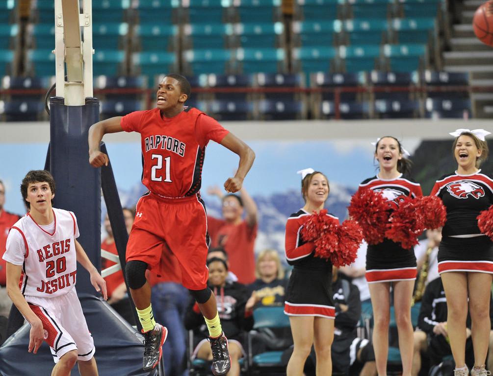 . DENVER, CO. - MARCH 08: Jaisean Jackson #21 of Eaglecrest High School celebrates winning their 5A quarter final game over Regis High School at Denver Coliseum. March 8, 2013. Denver, Colorado. Eaglecrest won 64-57. (Photo By Hyoung Chang/The Denver Post)