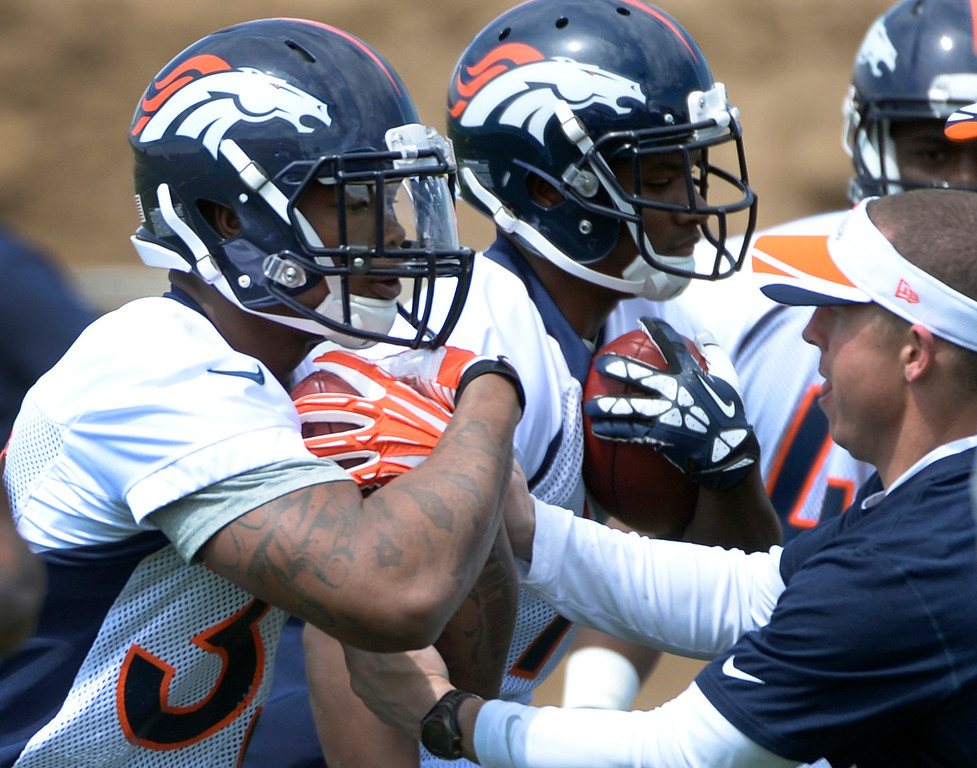. Kapri Bibbs (35) runs through drills with fellow rookies as the Denver Broncos host their rookie minicamp at Dove Valley in Englewood on Friday, May 16, 2014.  (Kathryn Scott Osler, The Denver Post)