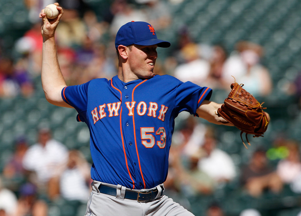 . New York Mets starting pitcher Jeremy Hefner works against the Colorado Rockies in the first inning of a baseball game in Denver on Thursday, June 27, 2013. (AP Photo/David Zalubowski)