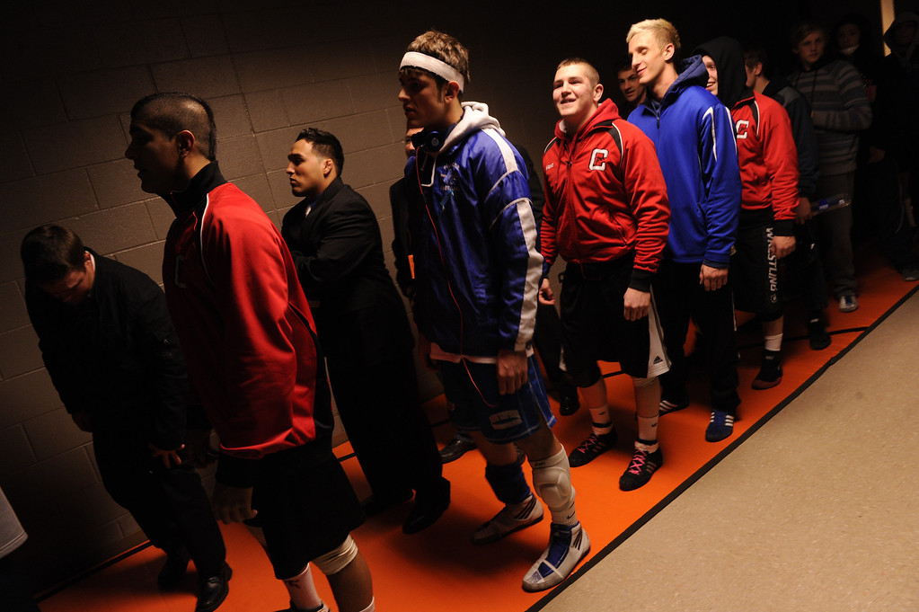 . DENVER, CO. - FEBRUARY 23: Wrestlers lined up for the Parade of Champions before the final matches Saturday night. The CHSAA State Wrestling Tournament wrapped up, February 23, 2013, with final matches following the Parade of Champions at the Pepsi Center in downtown Denver. (Photo By Karl Gehring/The Denver Post)