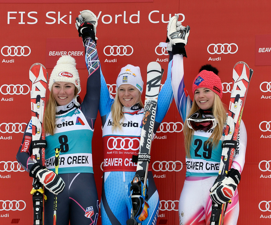 . First-place Jessica Lindell-Vikarby of Sweden (C), Second-place Mikaela Shiffrin of the USA (L), and Third-place Tina Weirather of Liechtenstein (R) celebrates on the awards podium after the second run in the women\'s Giant Slalom at the FIS World Cup Alpine Skiing in Beaver Creek, Colorado, USA, 01 December 2013.  EPA/JOHN G. MABANGLO