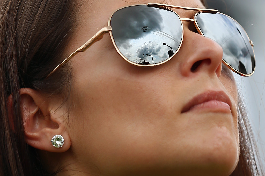 . The United States Air Force Thunderbirds are reflected in the sunglasses of Danica Patrick, driver of the #10 GoDaddy Chevrolet, as they fly over during pre-race ceremonies for the NASCAR Sprint Cup Series Daytona 500 at Daytona International Speedway on February 23, 2014 in Daytona Beach, Florida.  (Photo by Tom Pennington/Getty Images)