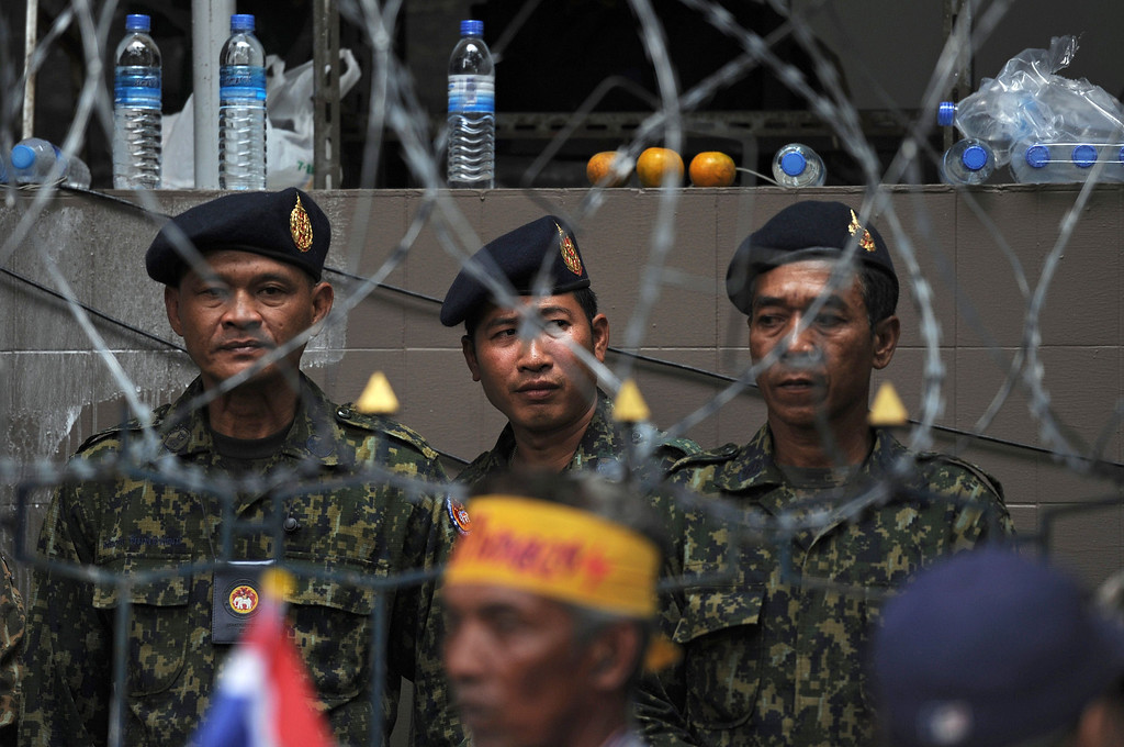 . Thai members of the security forces stand behind barbed wire while guarding the Interior Ministry as opposition protesters surround it in Bangkok on November 26, 2013.   AFP PHOTO/Christophe  ARCHAMBAULT/AFP/Getty Images