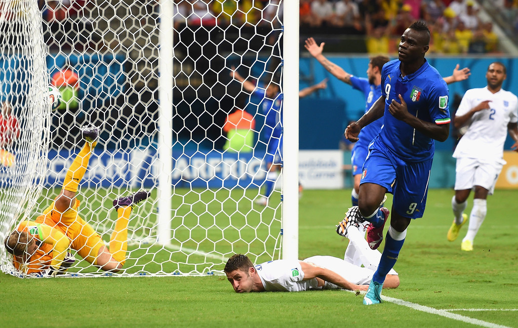 . Mario Balotelli of Italy celebrates after scoring the second goal during the 2014 FIFA World Cup Brazil Group D match between England and Italy at Arena Amazonia on June 14, 2014 in Manaus, Brazil.  (Photo by Christopher Lee/Getty Images)
