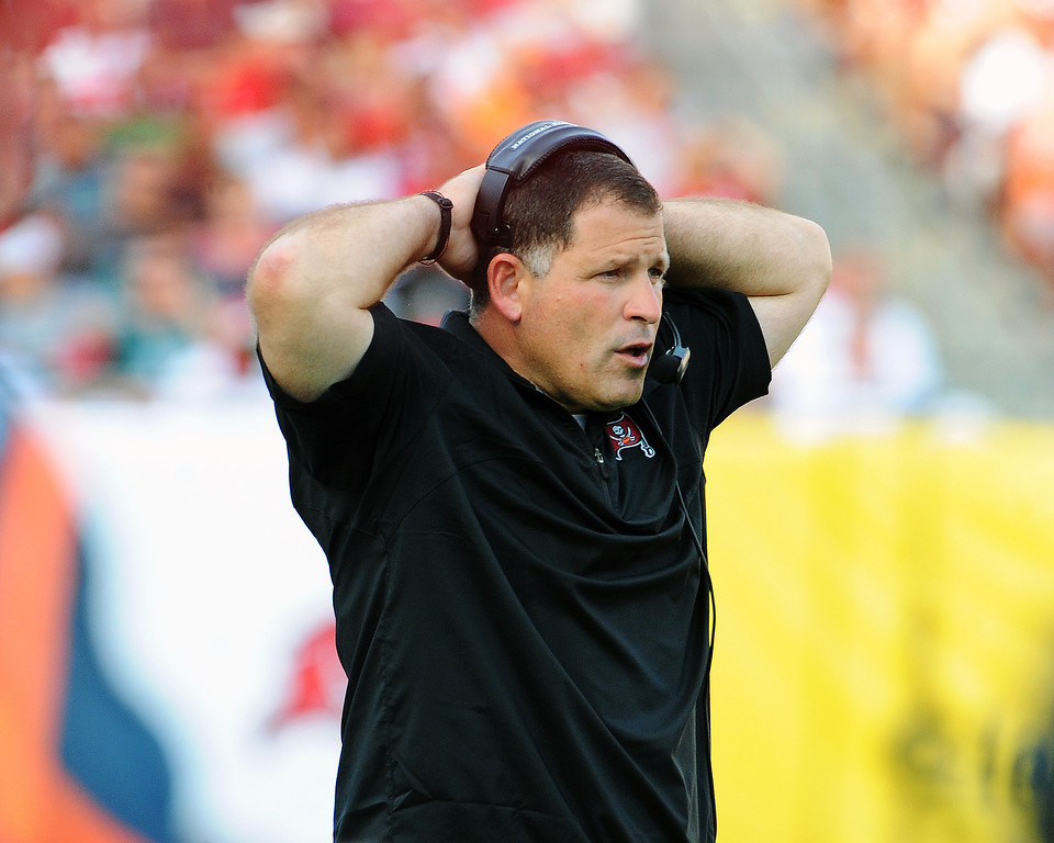 . TAMPA, FL - DECEMBER 9: Coach Greg Schiano of the Tampa Bay Buccaneers watches asthe Philadelphia Eagles drive for a fourth-quarter,  game-winning touchdown December 9, 2012 at Raymond James Stadium in Tampa, Florida.  The Eagles won 23 - 21. (Photo by Al Messerschmidt/Getty Images)