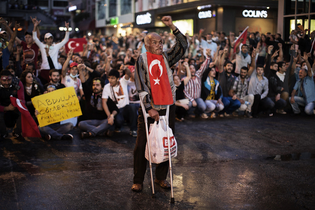 . An elderly man holds himself up with crutches as people demonstrate in Istanbul on June 4, 2013, during ongoing protests against the ruling party, police brutality, and the destruction of Taksim park for the sake of a development project.  AFP PHOTO / MARCO LONGARI/AFP/Getty Images