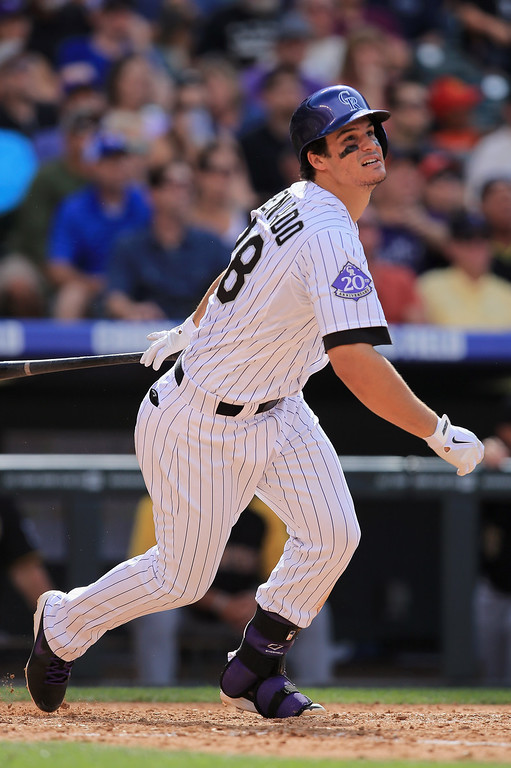 . Nolan Arenado #28 of the Colorado Rockies watches his game winning RBI double off of Bryan Morris #29 of the Pittsburgh Pirates to score Wilin Rosario #20 of the Colorado Rockies in the seventh inning at Coors Field on August 11, 2013 in Denver, Colorado. The Rockies defeated the Pirates 3-2.  (Photo by Doug Pensinger/Getty Images)