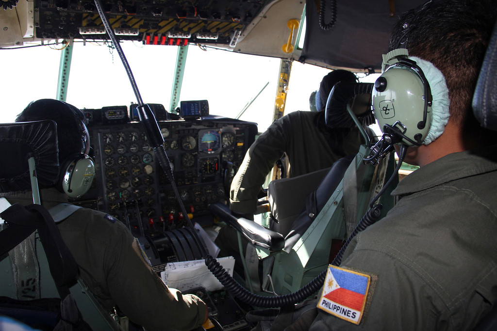 . In this photo taken Tuesday, March 11, 2014, Philippine Air Force C-130 crew members continue their search and rescue mission over the South China Sea more than four days after a Malaysia Airlines jetliner went missing en route to Beijing. Authorities acknowledged Wednesday they didn\'t know which direction the plane carrying 239 passengers was heading when it disappeared, vastly complicating efforts to find it. Several dozen ships and aircraft from some 12 countries are continuing the search for the missing Boeing 777. (AP Photo/Philippine Air Force Western Command)