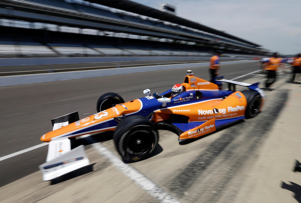 . Charlie Kimball pulls out of the pit area during practice for the Indianapolis 500 auto race at the Indianapolis Motor Speedway in Indianapolis, Wednesday, May 15, 2013. (AP Photo/Darron Cummings)
