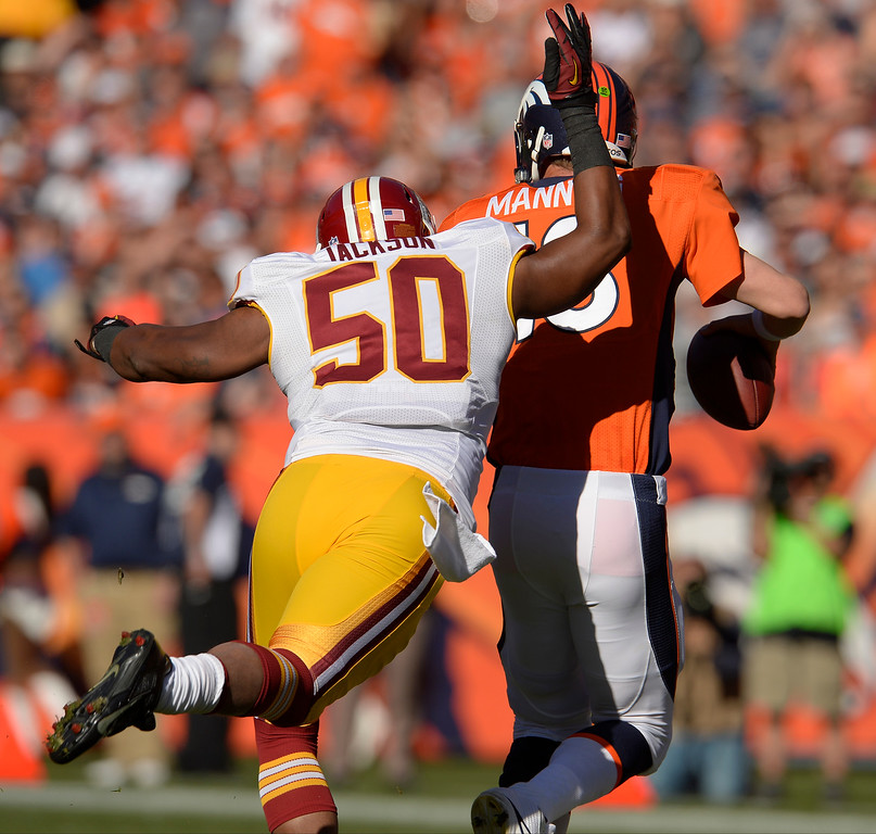 . Washington Redskins outside linebacker Rob Jackson (50) sacks Denver Broncos quarterback Peyton Manning (18) for a loss of five yards in the first quarter.   (Photo by Joe Amon/The Denver Post)