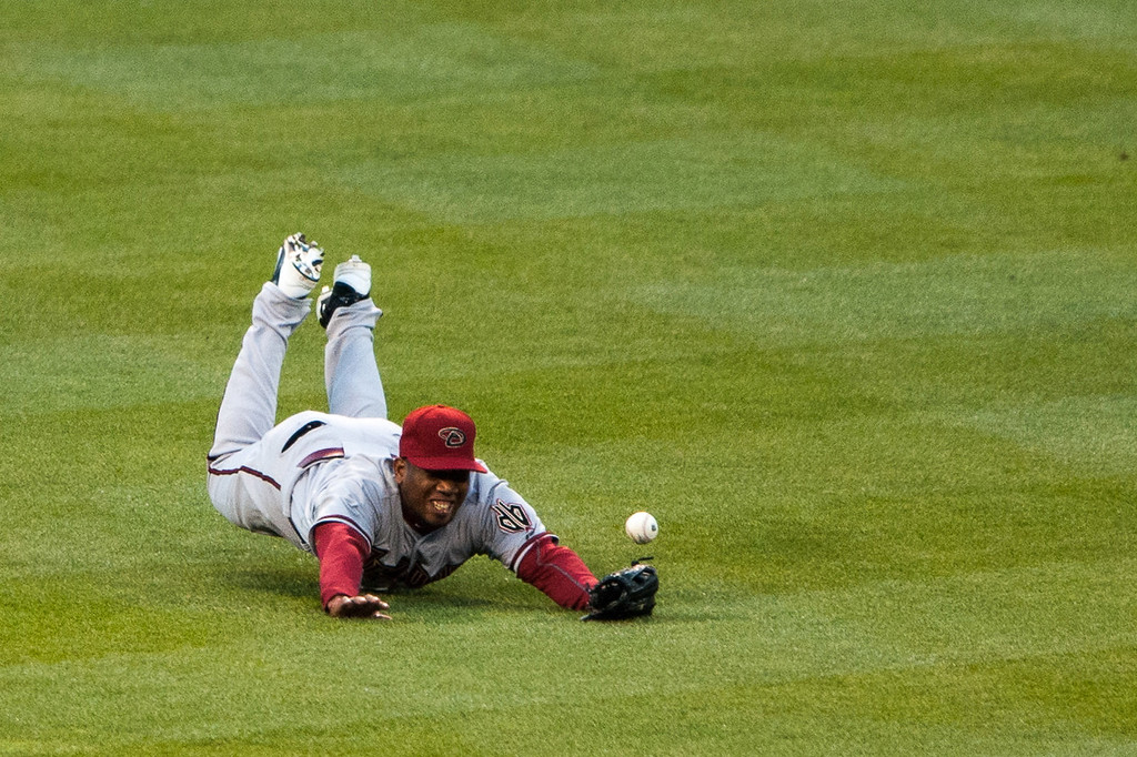 . DENVER, CO - APRIL 20:  Alfredo Marte #17 of the Arizona Diamondbacks dives but fails to make a catch in the fourth inning of a game against the Colorado Rockies at Coors Field on April 20, 2013 in Denver, Colorado. The Rockies beat the Diamondbacks 4-3. (Photo by Dustin Bradford/Getty Images)
