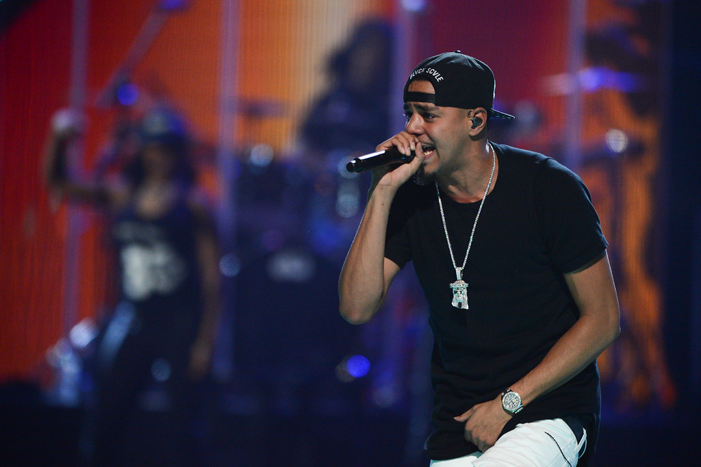 . J. Cole performs at IHeartRadio Music Festival, day 1, on Friday, Sept. 20, 2013 in Las Vegas. (Photo by Al Powers/Powers Imagery/Invision/AP)
