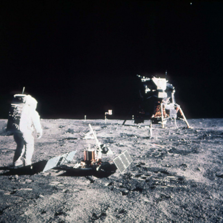 . Astronaut Edwin E. Aldrin Jr., lunar module pilot, stands on the lunar surface after the Apollo 11 moon landing on July 20, 1969.  The Lunar Module is seen in the background.  (AP PHOTO)