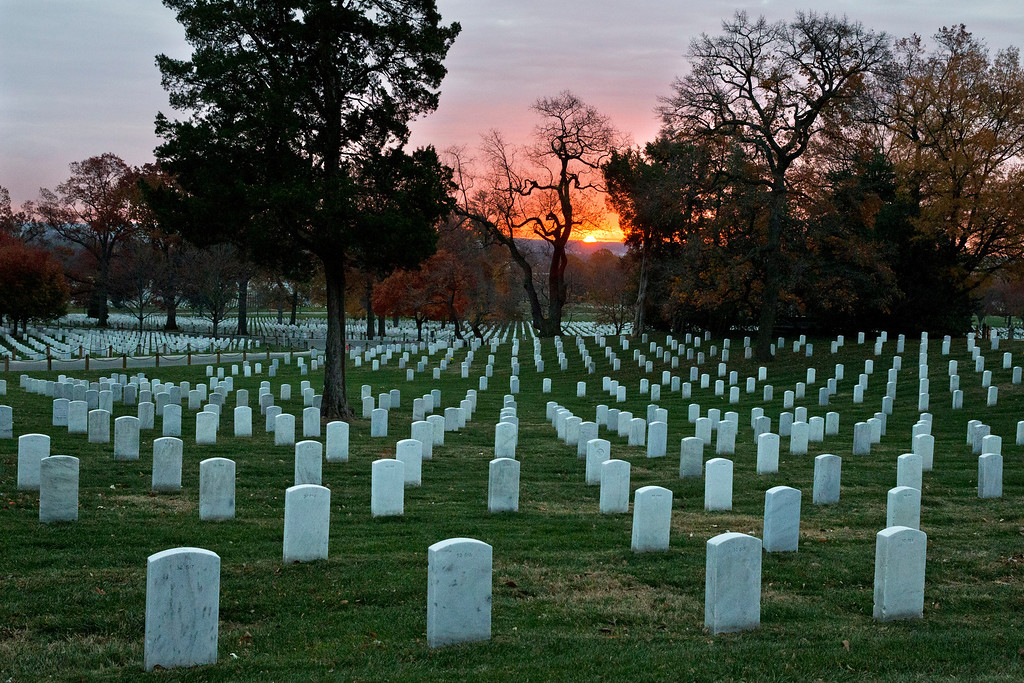 . The sun rises over Arlington National Cemetery on the 50th anniversary of the death of President John F. Kennedy, Friday, Nov. 22, 2013. (AP Photo/Jacquelyn Martin)
