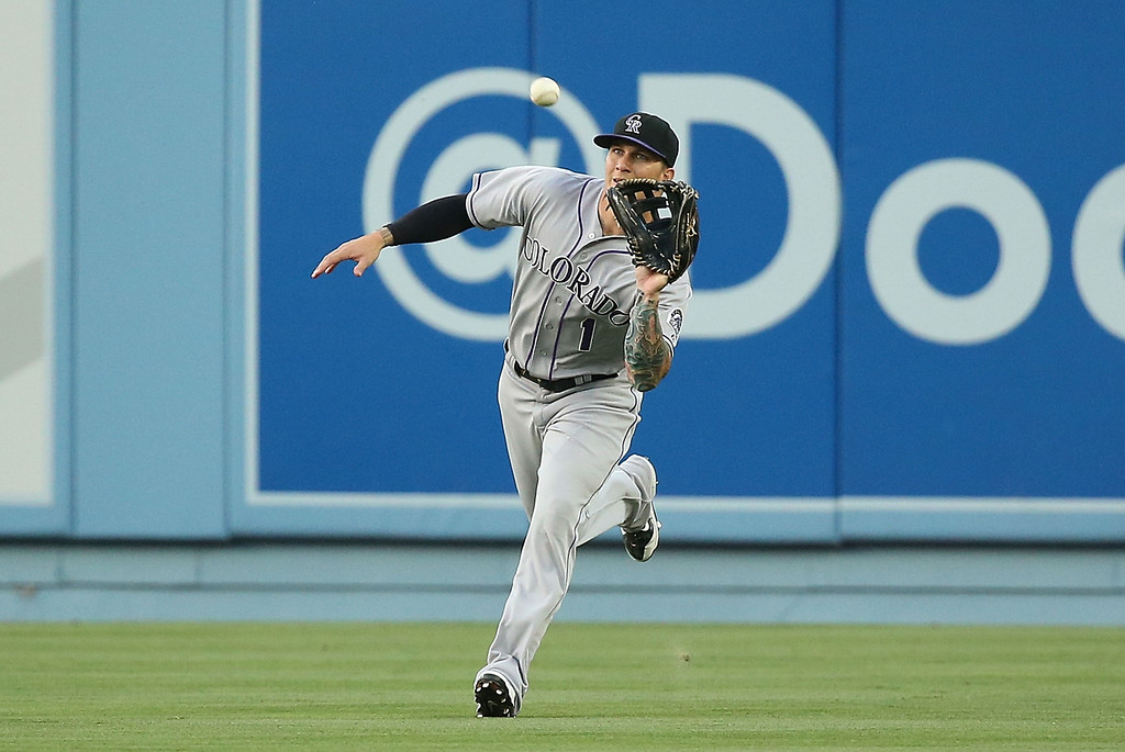 . LOS ANGELES, CA - JUNE 18: Brandon Barnes #1 of the Colorado Rockies gets under a fly ball to right field for the third out of the first inning during the MLB game against the Los Angeles Dodgers at Dodger Stadium on June 18, 2014 in Los Angeles, California.  (Photo by Victor Decolongon/Getty Images)