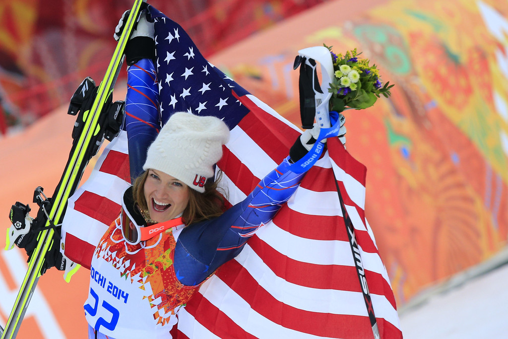 . US skier Julia Mancuso poses on the podium after the Women\'s Alpine Skiing Super Combined Flower Ceremony at the Rosa Khutor Alpine Center during the Sochi Winter Olympics on February 10, 2014.  AFP PHOTO / ALEXANDER KLEIN/AFP/Getty Images