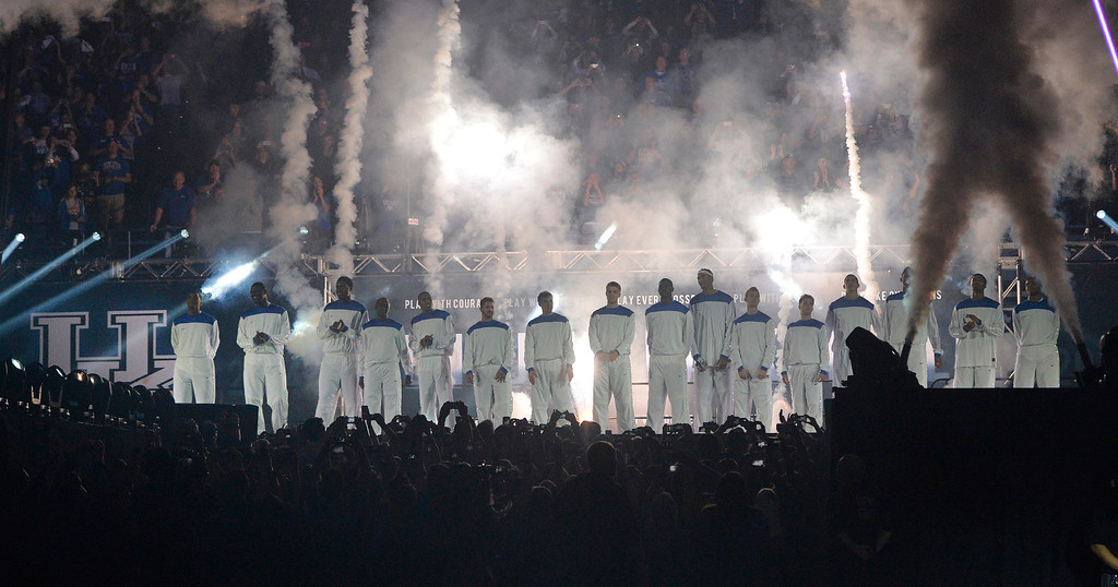 . The Kentucky men\'s basketball team is introduced for the NCAA college basketball team\'s Big Blue Madness, Friday, Oct. 18, 2013, in Lexington, Ky.(AP Photo/Timothy D. Easley)