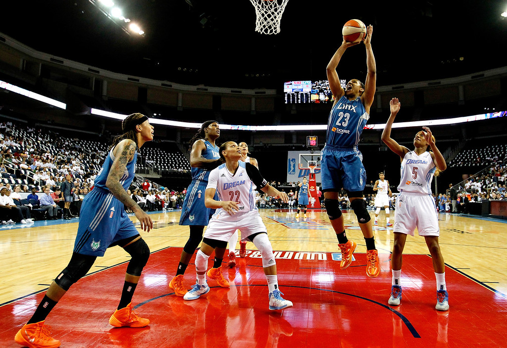 . ATLANTA, GA - OCTOBER 10:  Maya Moore #23 of the Minnesota Lynx shoots against Jasmine Thomas #5 and Armintie Herrington #22 of the Atlanta Dream during Game Three of the 2013 WNBA Finals at Philips Arena on October 10, 2013 in Atlanta, Georgia.  (Photo by Kevin C. Cox/Getty Images)