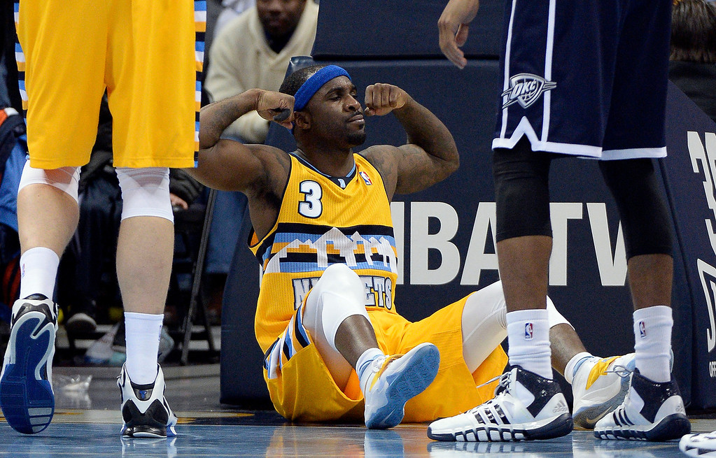 . Denver Nuggets point guard Ty Lawson (3) flexes his muscles after making a basket driving to the hoop against the Oklahoma City Thunder in the third quarter January 9, 2014 at Pepsi Center. (Photo by John Leyba/The Denver Post)