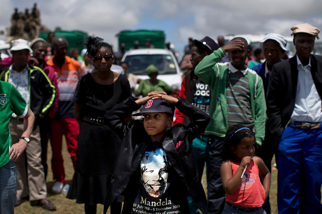 . Mourners short after the end of the burial ceremony of former South African President Nelson Mandela in his hometown Qunu, South Africa, Sunday Dec. 15, 2013. (AP Photo/Bernat Armangue)