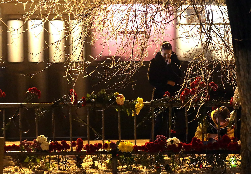 . Women grieve at the site of the second terrorist explosion happened on a trollybus, at a street in Volgograd, Russia, late Monday, Dec. 30. According to media reports, at least 31 people were killed and many were injured in two suicide bombing attack in the city during the last two days.  EPA/MAXIM SHIPENKOV