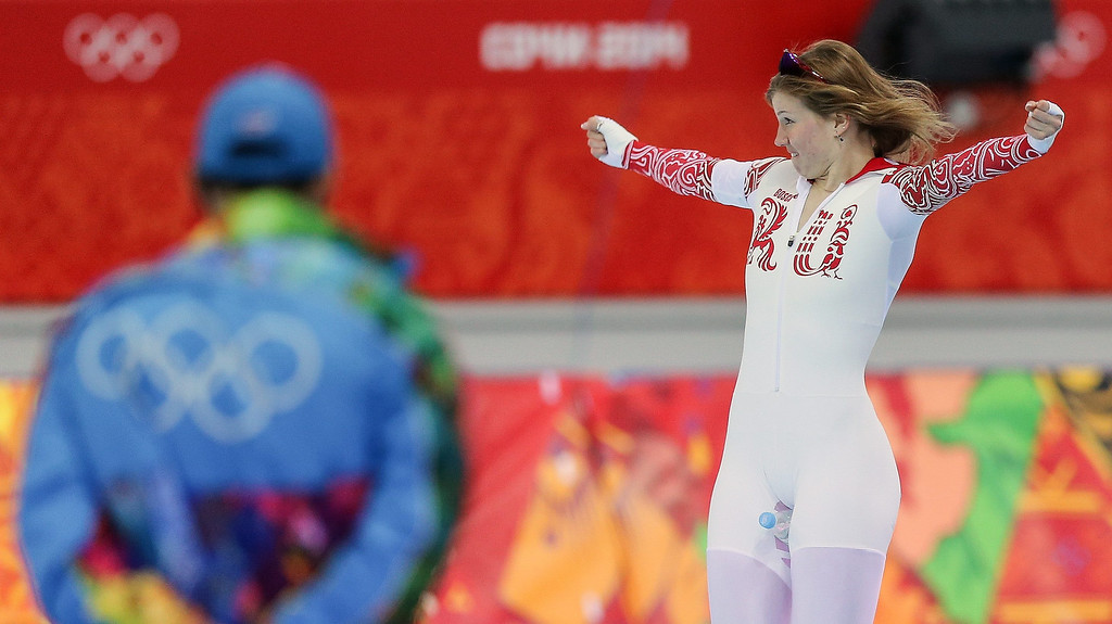 . Olga Fatkulina (R) of Russia reacts after winning Silver after the women\'s 500 m Speed Skating event in the Adler Arena at the Sochi 2014 Olympic Games, Sochi, Russia, on Feb. 11, 2014.  EPA/HANNIBAL HANSCHKE