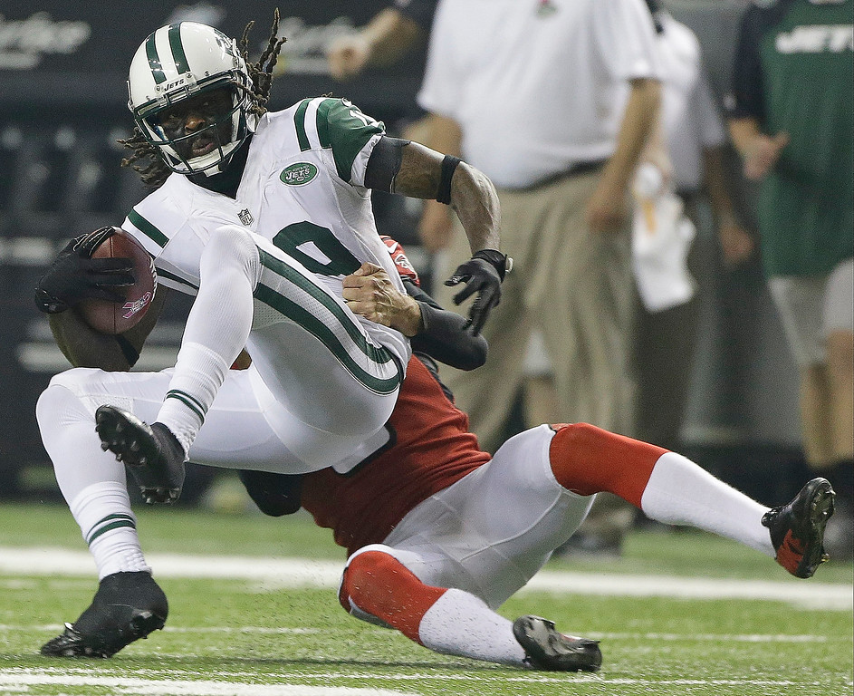 . Atlanta Falcons punter Matt Bosher (5) tackles New York Jets wide receiver Clyde Gates (19) during the first half of an NFL football game, Monday, Oct. 7, 2013, in Atlanta. (AP Photo/John Bazemore)