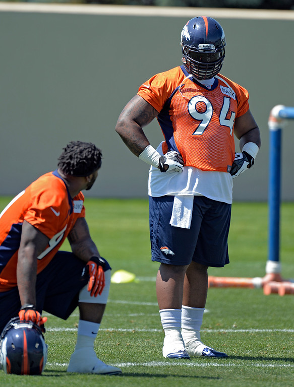 . Terrance Knighton (94) of the Denver Broncos chats with Robert Ayers (91) during mini camp June 11, 2013 at Dove Valley. (Photo By John Leyba/The Denver Post)