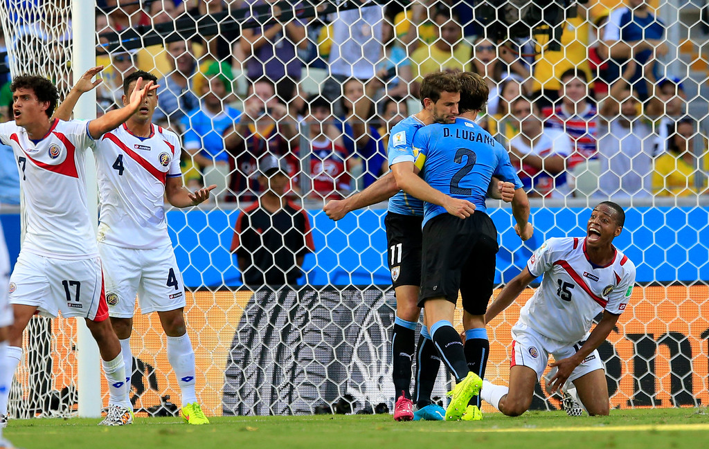 . Uruguay\'s Christian Stuani and Uruguay\'s Diego Lugano celebrate after getting a penalty during the group D World Cup soccer match between Uruguay and Costa Rica at the Arena Castelao in Fortaleza, Brazil, Saturday, June 14, 2014.(AP Photo/Bernat Armangue)