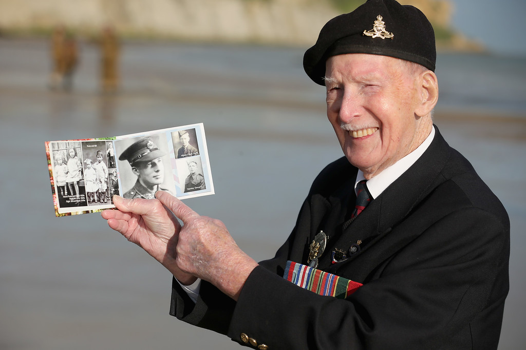. D-Day veteran Bill Price, aged 99, who celebrates his 100th birthday on July 24, poses on Gold Beach for well wishers after the last ever flag raising ceremony by the Surrey Normandy Veterans Association on June 6, 2014 in Arromanches Les Bains, France.   (Photo by Christopher Furlong/Getty Images)