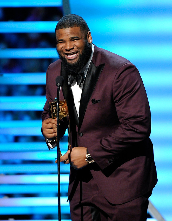 . Sheldon Richardson of the New York Jets speaks after receiving the award for AP Defensive Rookie of the Year, at the third annual NFL Honors at Radio City Music Hall on Saturday, Feb. 1, 2014, in New York. (Photo by Evan Agostini/Invision for NFL/AP Images)