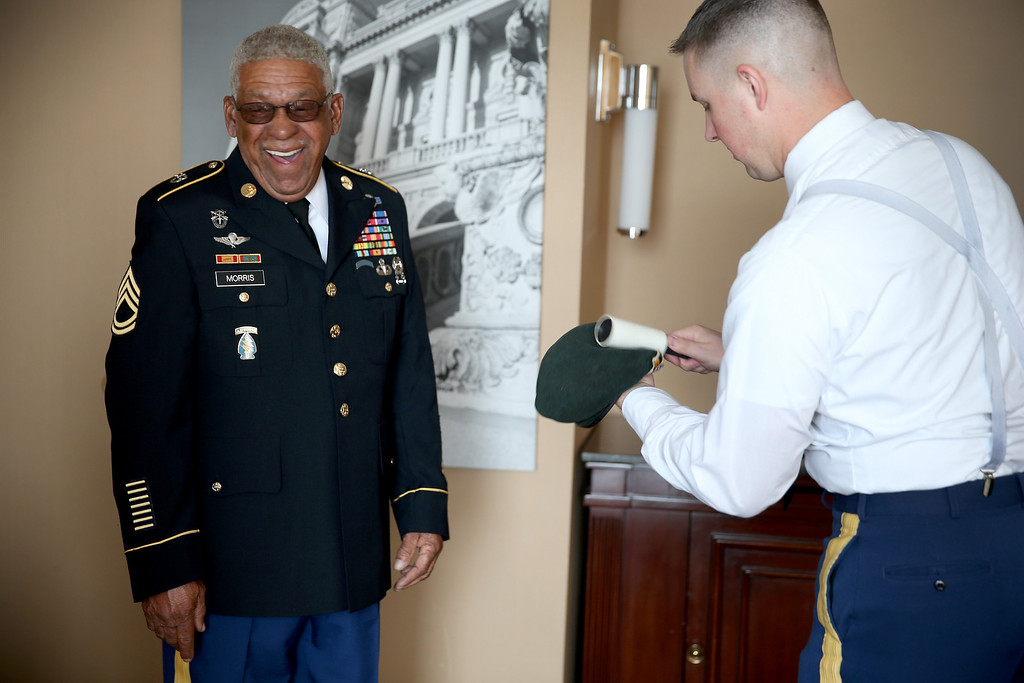 . U.S. Army Staff Sgt. (Ret.) Melvin Morris (L), a Vietnam War veteran, and U.S. Army Staff Sergeant Christopher Schneider, from U.S. Army Old Guard, 3d U.S. Infantry Regiment, prepare his uniform before heading to the White House on March 18, 2014 in Washington,DC.  (Photo by Joe Raedle/Getty Images)