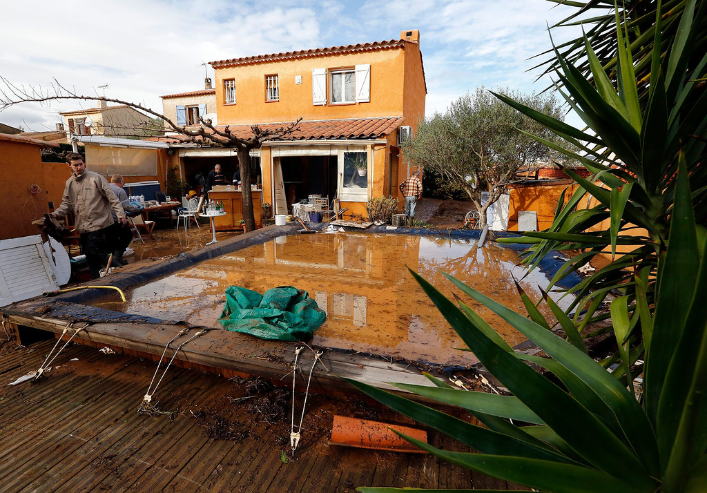 . A man cleans his flooded house in La Londe Les Maures, near Hyeres, Southern France, 20 January 2014. The heavy rains flooded the French Riviera, leaving two people dead.  EPA/SEBASTIEN NOGIER