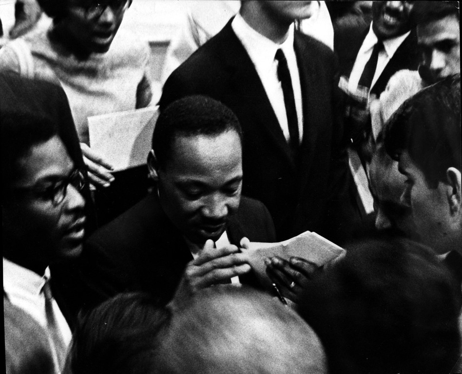 . Rev. Dr. Martin Luther King Jr. signs autographs at DU Arena, May 18, 1967.  Photo by Bill Peters, The Denver Post