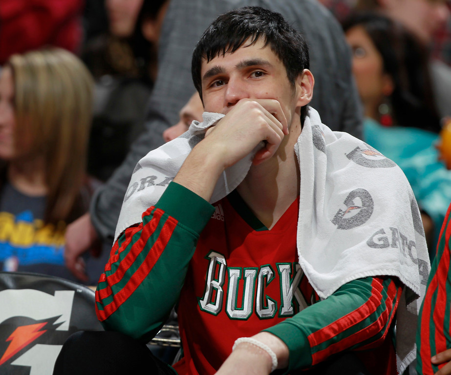 . Milwaukee Bucks forward Ersan Ilyasova, of Turkey, looks on from bench late in the fourth quarter of the Denver Nuggets\' 110-100 victory over the Bucks in an NBA basketball game in Denver on Wednesday, Feb. 5, 2014. (AP Photo/David Zalubowski)