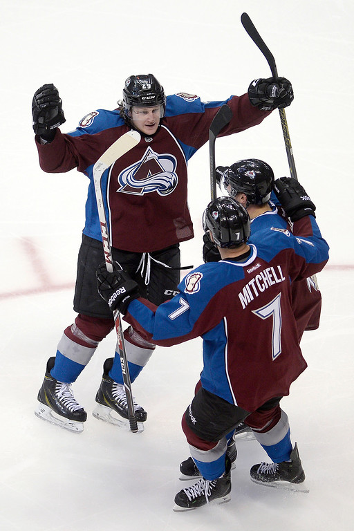 . John Mitchell (7) of the Colorado Avalanche celebrates his goal with Nathan MacKinnon (29) and Tyson Barrie (4) against the Winnipeg Jets during the first period. (Photo by AAron Ontiveroz/The Denver Post)
