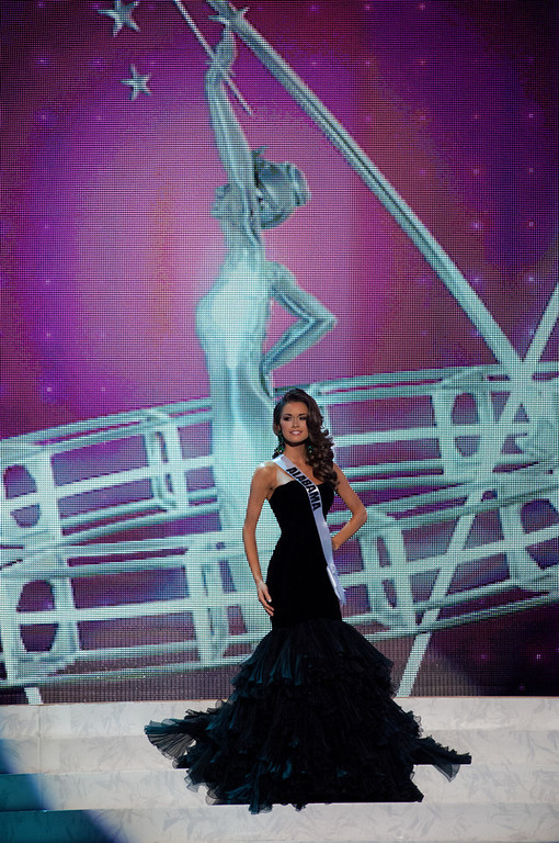 . This photo provided by the Miss Universe Organization, Miss Alabama USA 2013, Mary Margaret McCord competes in her evening gown during the 2013 Miss USA Competition Preliminary Show  in Las Vegas  on Wednesday June 12, 2013.  She will compete for the title of Miss USA 2013 and the coveted Miss USA Diamond Nexus Crown on June 16, 2013.  (AP Photo/Miss Universe Organization, Patrick Prather)