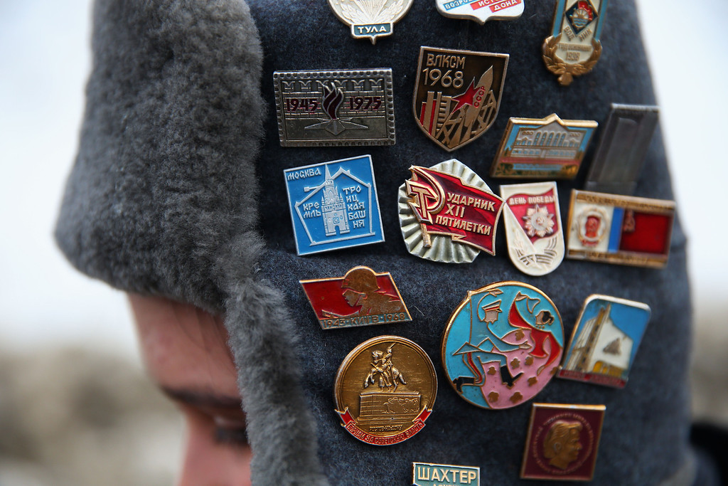 . A pin collector displays his badges ahead of the Men\'s Luge Singles on Day 2 of the Sochi 2014 Winter Olympics at Sliding Center Sanki on February 9, 2014 in Sochi, Russia.  (Photo by Alexander Hassenstein/Getty Images)