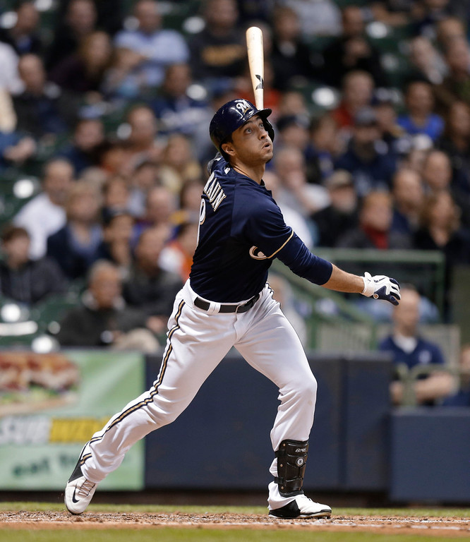 . Milwaukee Brewers\' Ryan Braun watches his two-run home run against the Colorado Rockies during the third inning of a baseball game Tuesday, April 2, 2013, in Milwaukee. (AP Photo/Jeffrey Phelps)