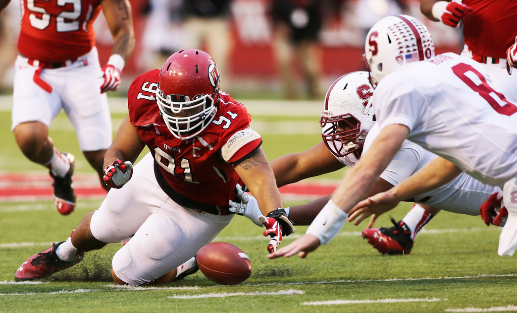 . SALT LAKE CITY, UT - OCTOBER 12: Tenny Palepoi #91 of the Utah Utes gathers in a fumble by Kevin Hogan #8 of the Stanford Cardinal during the second half of an NCAA football game October 12, 2013 at Rice Eccles Stadium in Salt Lake City, Utah. Utah Beat Stanford 27-21. (Photo by George Frey/Getty Images)