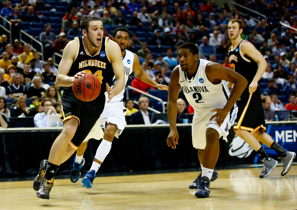. BUFFALO, NY - MARCH 20: Austin Arians #34 of the Milwaukee Panthers drives to the basket as Kris Jenkins #2 of the Villanova Wildcats defends during the second round of the 2014 NCAA Men\'s Basketball Tournament at the First Niagara Center on March 20, 2014 in Buffalo, New York.  (Photo by Jared Wickerham/Getty Images)