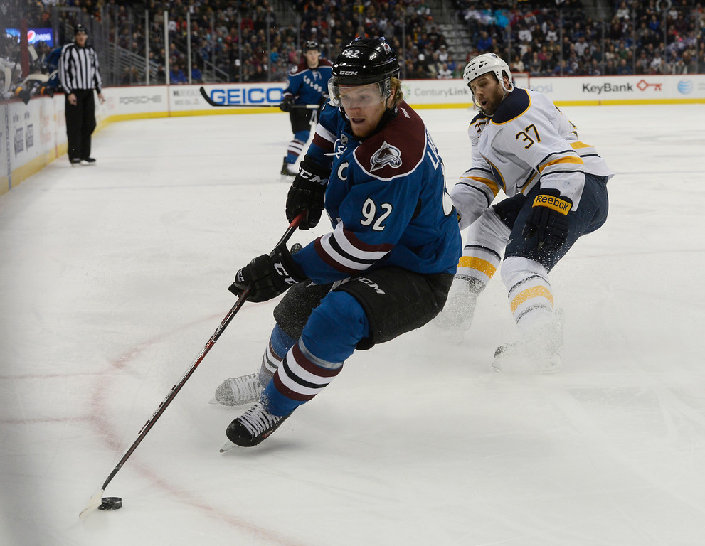 . Colorado Avalanche center, Gabriel Landeskog, left, advances the puck against Matt Ellis, Buffalo Sabres, in the first period at the Pepsi Center Saturday afternoon, February 01, 2014. (Photo By Andy Cross / The Denver Post)