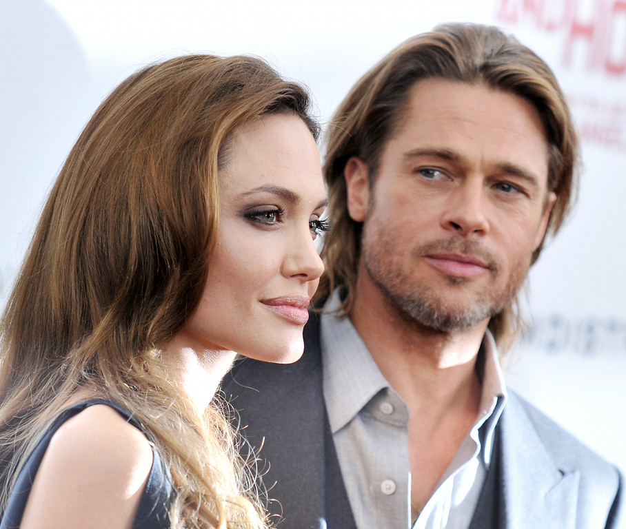 """. Angelina Jolie and Brad Pitt attend the premiere of \""""In the Land of Blood and Honey\"""" at the School of Visual Arts on December 5, 2011 in New York City.  (Photo by Stephen Lovekin/Getty Images)"""