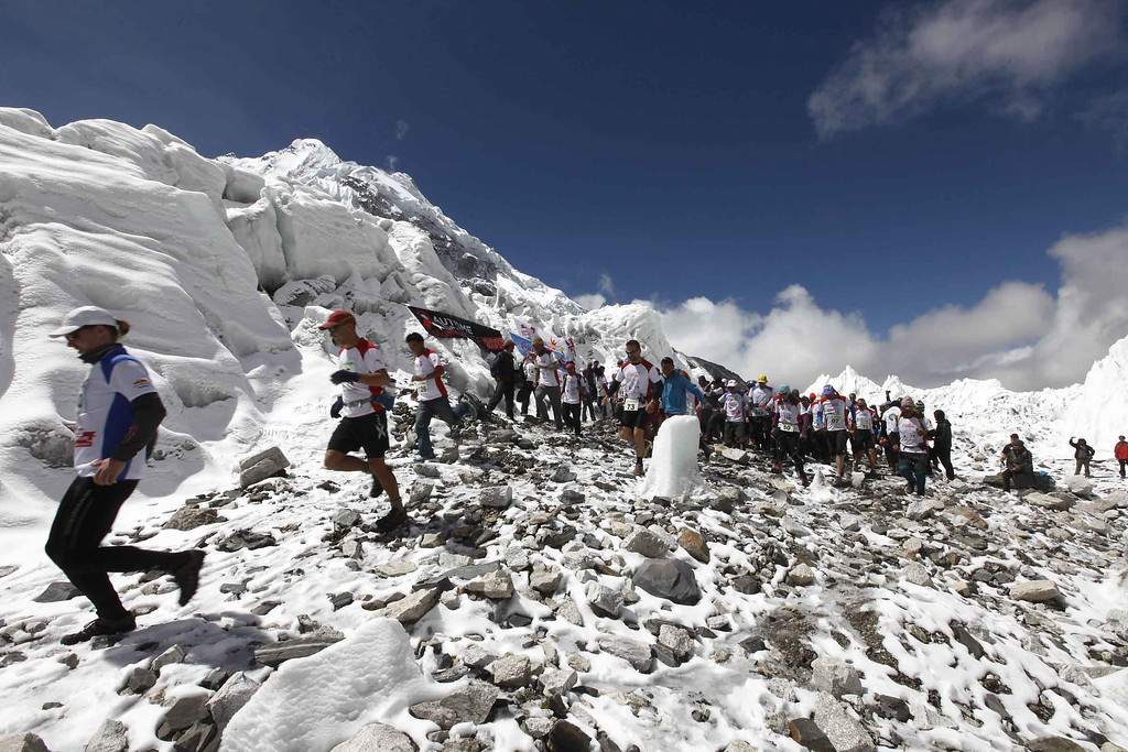 . The Tenzing-Hillary Everest Marathon, the world�s highest marathon, starts near the famous Khumbu Ice Fall at Qomolangma Base Camp (5,364 meters above sea level) and finishes at Namche Bazar (3,440 meters above sea level), on May 29, 2013.  Nepali athlete Ram Kumar Rajbhandari (31) clinched the title of the 11th Tenzing Hillary Everest Marathon, completing the 42.19 km race in 3 hour 59 minute 45 seconds as Nepali athletes continued their dominance in the highest altitude marathon claiming all top ten positions.      AFP/Getty/ HIMEX-Tenzing-Hillary Everest Marathon