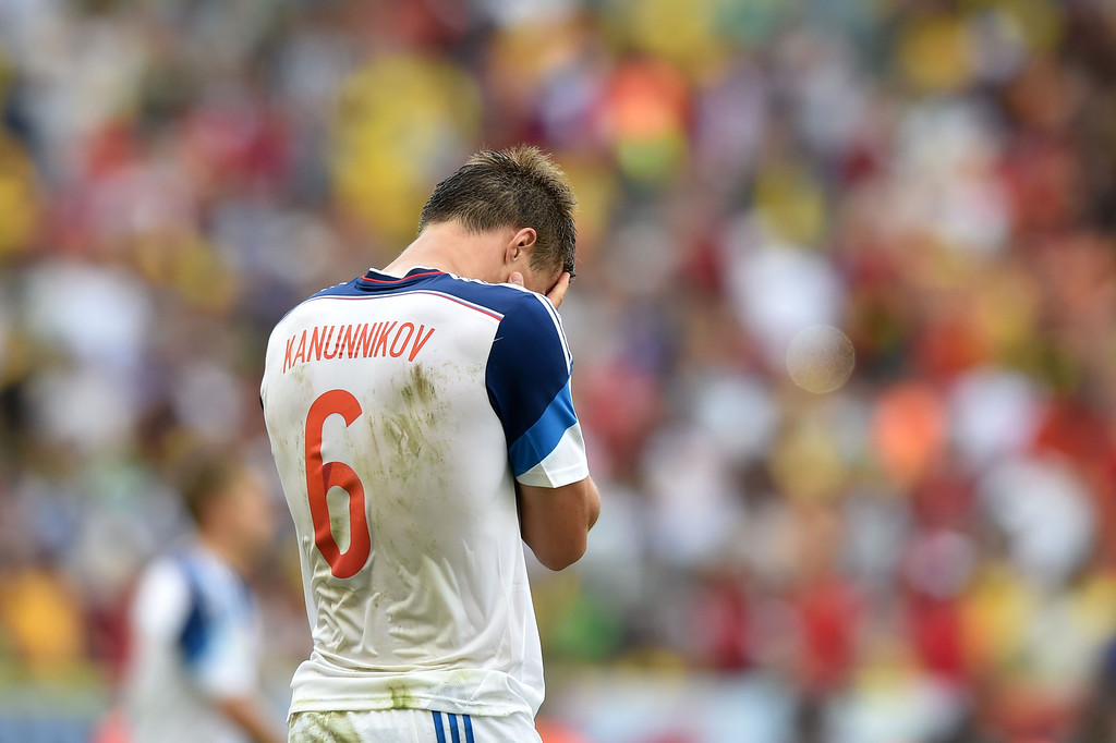 . Russia\'s forward Maxim Kanunnikov reacts at the end of the Group H football match between Belgium and Russia at the Maracana Stadium in Rio de Janeiro during the 2014 FIFA World Cup on June 22, 2014. AFP PHOTO / KIRILL KUDRYAVTSEV