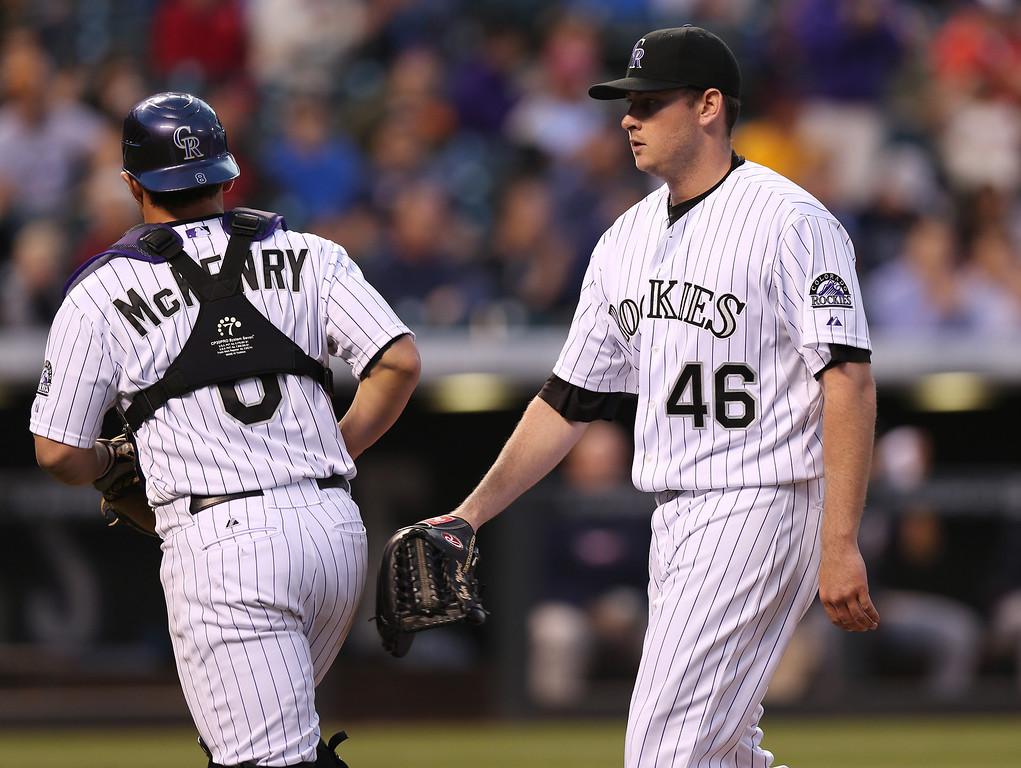 . Colorado Rockies catcher Michael McKenry, left, congratulates starting pitcher Tyler Matzek after he retired the Atlanta Braves in the sixth inning of a baseball game in Denver on Wednesday, June 11, 2014. (AP Photo/David Zalubowski)