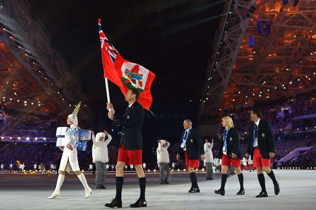 . Bermuda\'s flag bearer, cross-country skier Tucker Murphy leads his national delegation during the Opening Ceremony of the Sochi Winter Olympics at the Fisht Olympic Stadium on February 7, 2014 in Sochi.  AFP PHOTO / ALBERTO  PIZZOLI/AFP/Getty Images