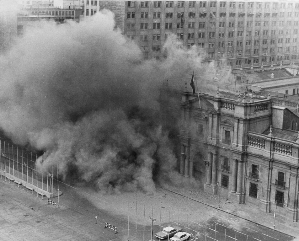 . In this Sept. 11, 1973 file photo, La Moneda presidential palace is bombed during a military coup to oust President Salvador Allende after which Gen. Augusto Pinochet seized power in Santiago, Chile. As bombs fell and rebelling troops closed in on the national palace, Allende avoided surrender by shooting himself with an assault rifle, ending Chile\'s experiment in nonviolent revolution and beginning 17 years of dictatorship. On Sept. 11, 2013, Chile marks the 40th anniversary of the coup. (AP Photo/File)